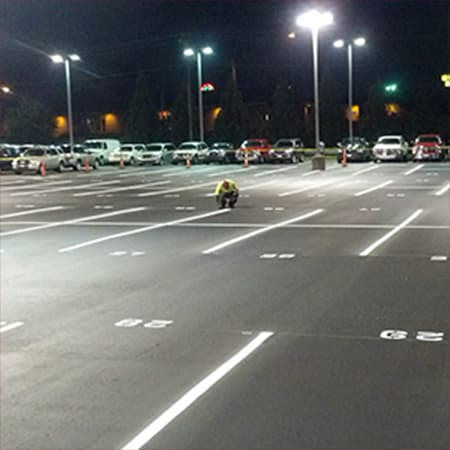 worker in parking lot